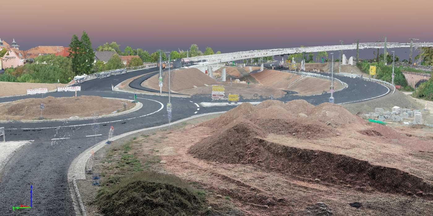 Bild eines Kreisverkehrs mit Brücke im Hintergrund als Punktwolke
